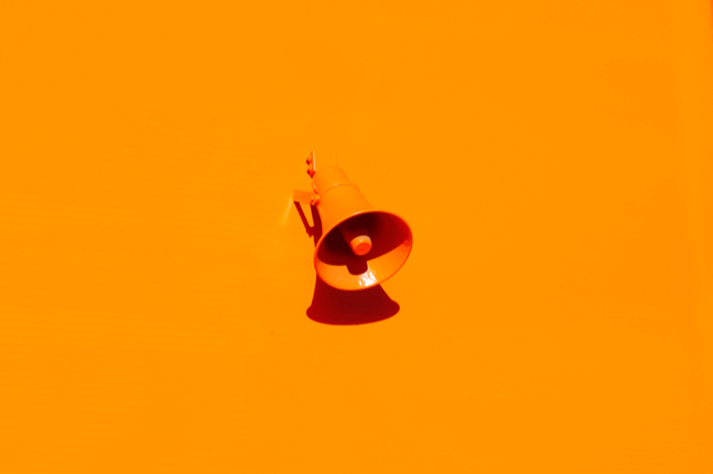 orange megaphone on orange background representing website marketing for business owners