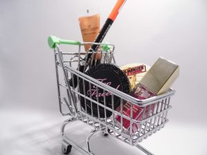 tiny shopping cart full of makeup and cosmetic products