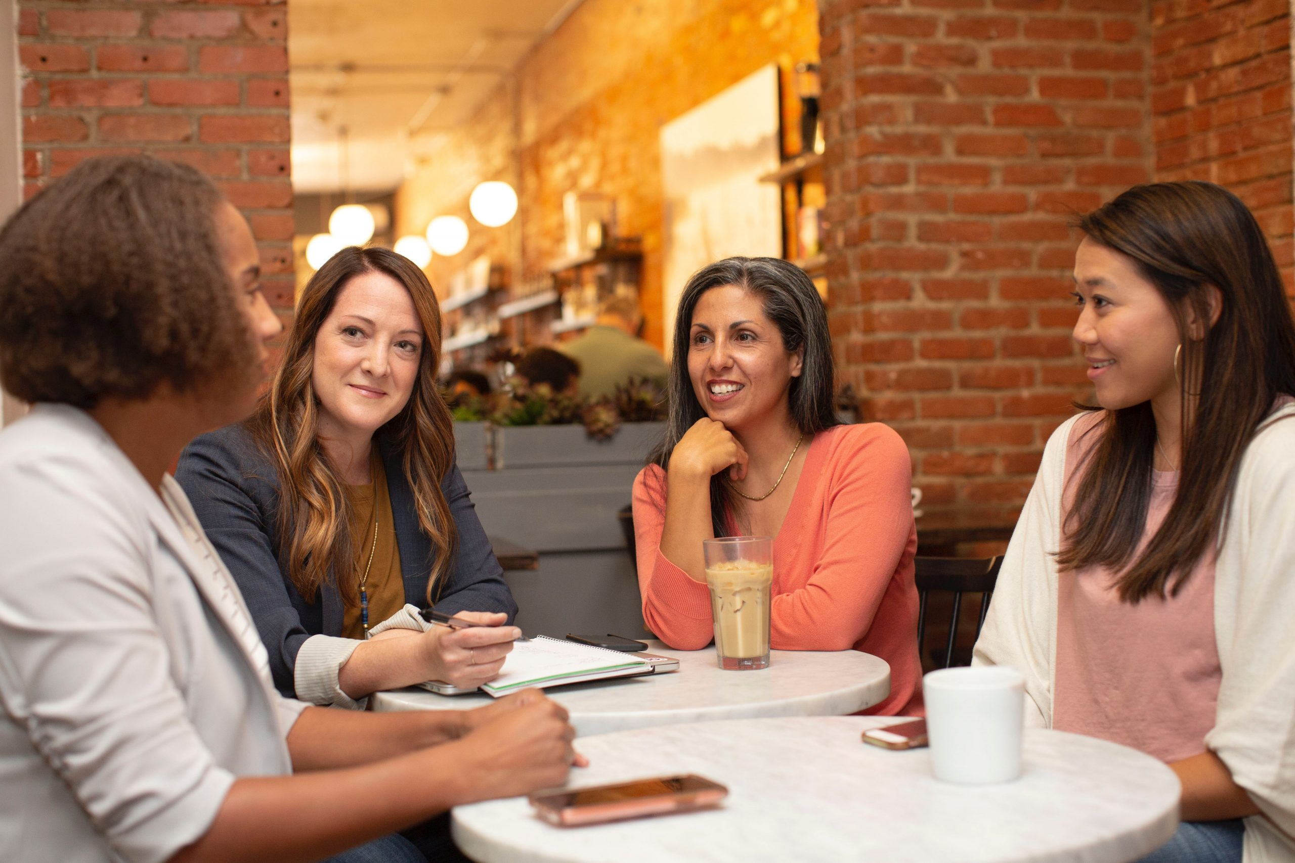Group of women sitting at a table and chatting