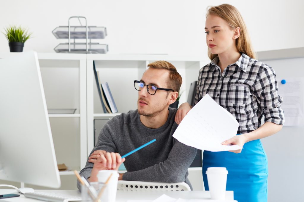 Two people working together in an office setting